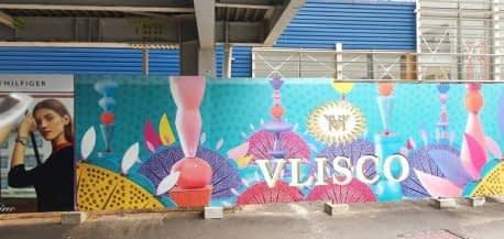 Habillage palissage en adhésif vinyle Vlisco Centre commercial Cap Sud